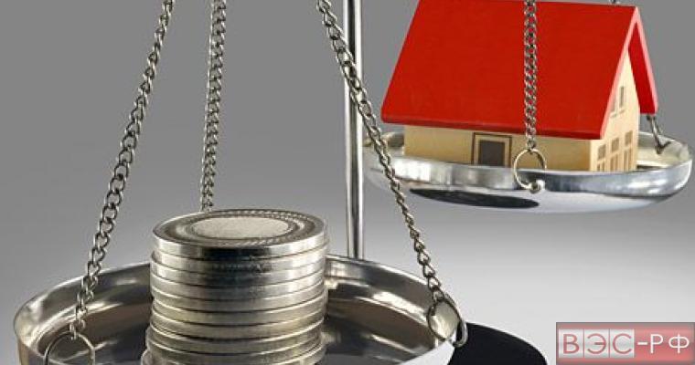 недвижимость налог весы монеты