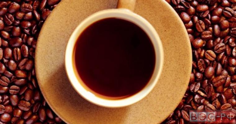 Чашка кофе и кофейные зёрна