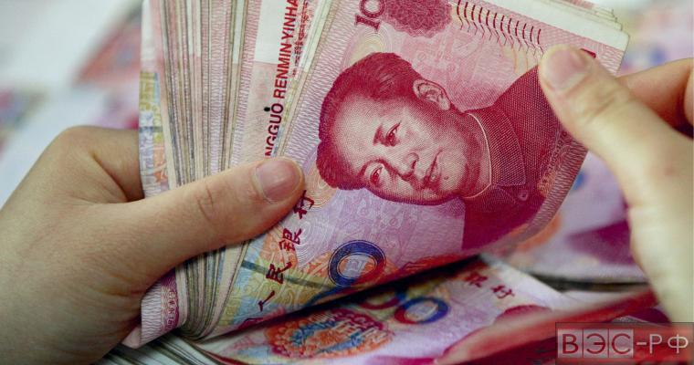 Китай продвигает свою валюту